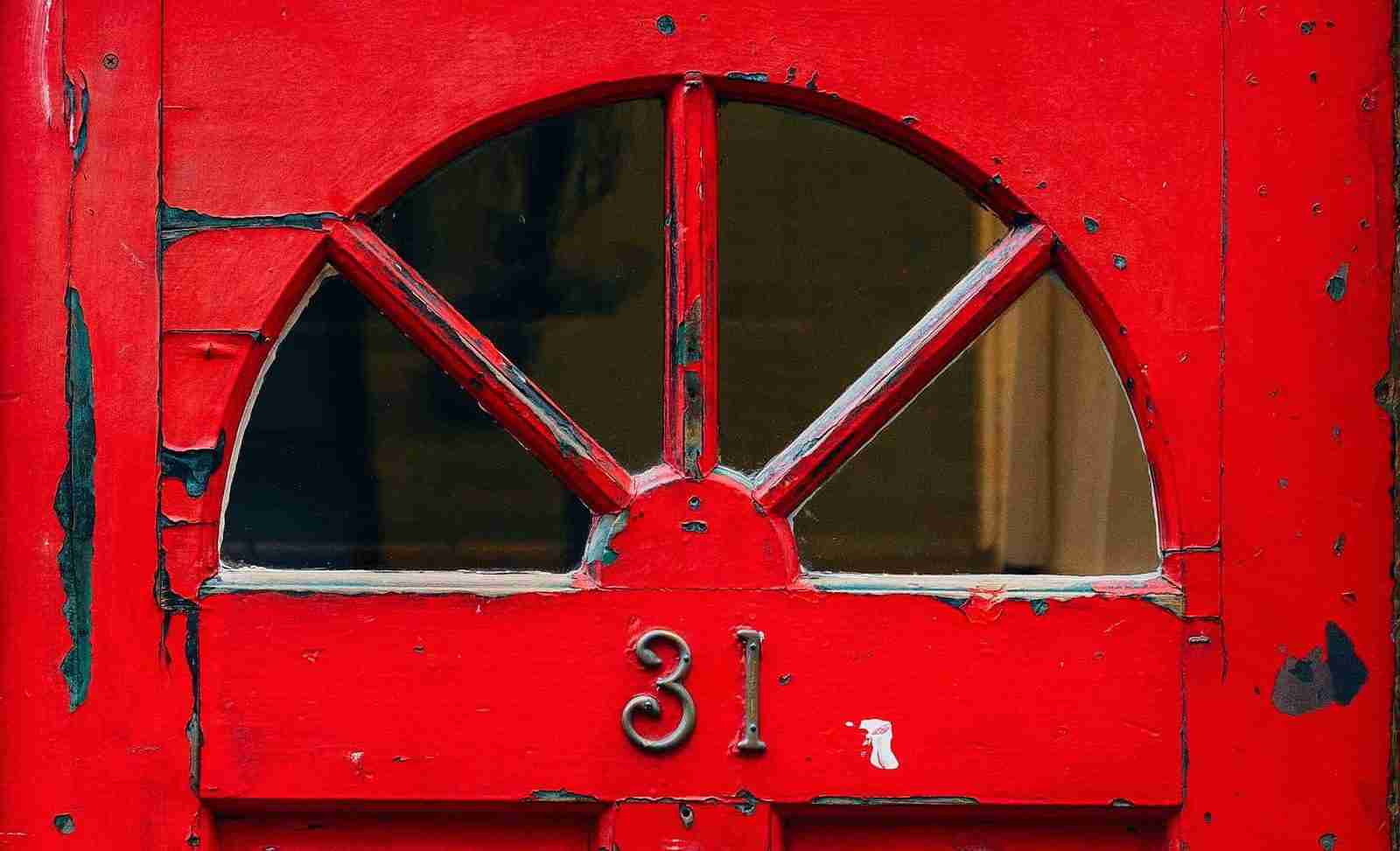 Red Door Lead Peeling Paint vertical - milkovi-unsplash